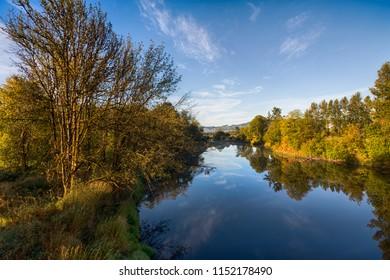 River landscape in sunny autumn morning. Chehalis river in Washington, USA