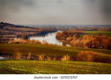 River landscape under grey sky, hdr horizontal image