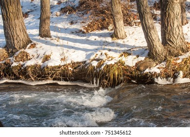River in late autumn. A landscape photo in late autumn. sunrise over the river late autumn. winter landscape of southern Kazakhstan