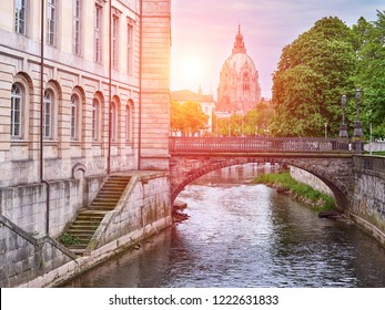 River Leine in Hanover city. City Hall background. View at sunset
