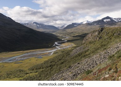 River meandering with daylight through Rapadalen valley Sarek, Sweden
