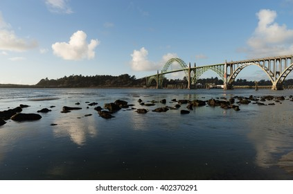 The river meets the Pacific Ocean under the Newport Bridge