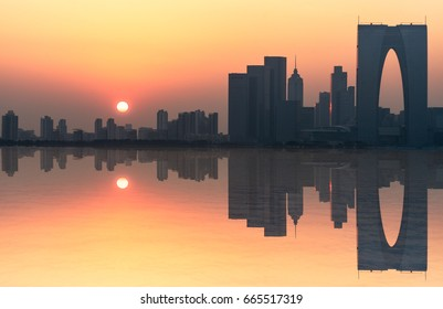 River And Modern Buildings Against Sky at dusk in Suzhou,China.