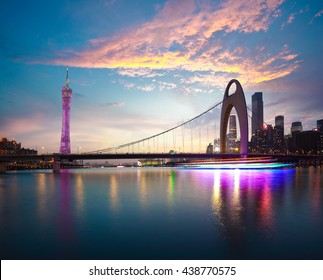 River with modern city landmark architecture backgrounds of pink clouds in Guangzhou China