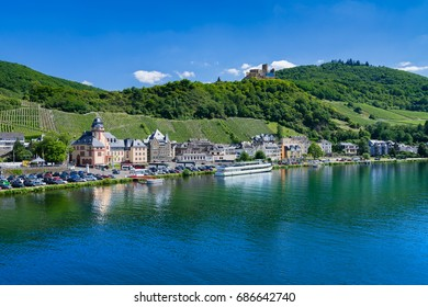 The river Moselle and Bernkastel-Kues, Germany. The twin town of Bernkastel-Kues is regarded as the most popular town and center of the Middle Moselle.