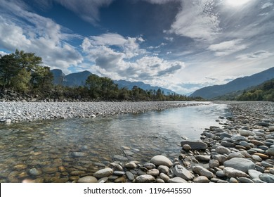 river and mountain landscape in the Swiss Alps in autum