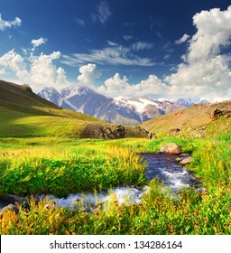 River in the mountain valley in the summer time. Beautiful landscape