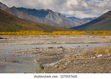 River and mountains in northern Alaska near the Dalton highway in summertime