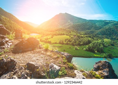 River and mountains in the sundown landscape