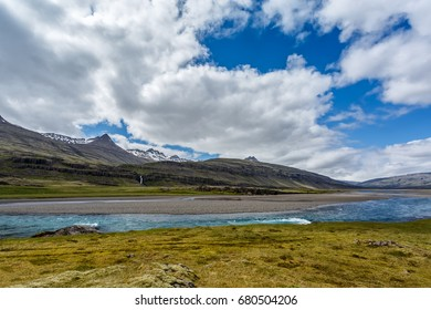The river and mountains under cloudy sky in Iceland