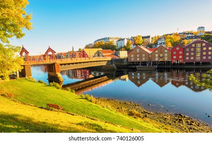 The river Nidelva, The Old Bridge  and historical timber buildings along the river in the norwegian city Trondheim in the indian summer