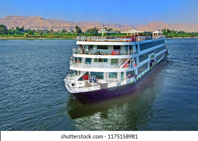 River Nile, Egypt, 2013.  A luxury Cruise Ship floating down the nile.  Cruise ships are a popular way for tourists to see the sights of ancient Egypt in style and luxury.