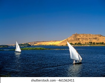 River Nile with feluccas in background monument to Aga Khan