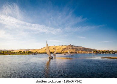 River nile with traditional blats at sunset. Live on the river Nile