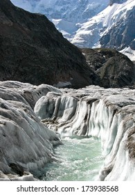 River at noon on Bezengi glacier in the Caucasus