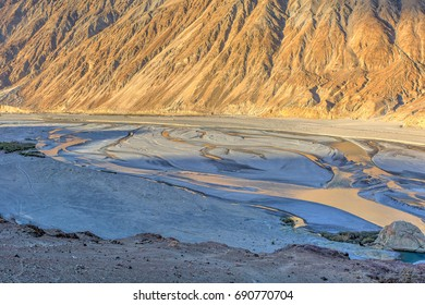 River Nuba in the desert of the Nubra Valley at sunset