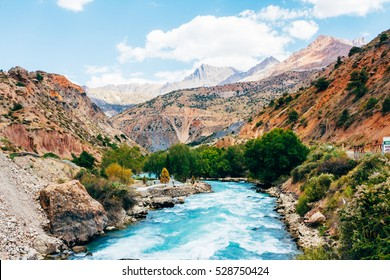 The river on the hills and mountains landscape in the Fann Mountains. Tajikistan. Central Asia. Road to Iskander Kul.