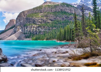 The river on the right is streaming into the blue lake Moraine. A beautiful and calming scenery.