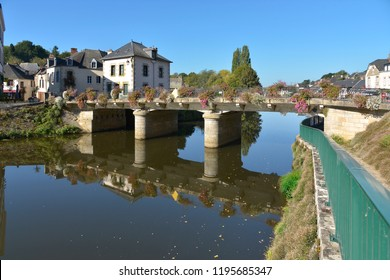 River Oust, part of canal Nantes at Brest, and flowered bridge at Josselin, a commune in the Morbihan department in Brittany in north-western France