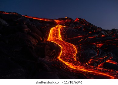 River of pahoehoe lava flowing down a cliff