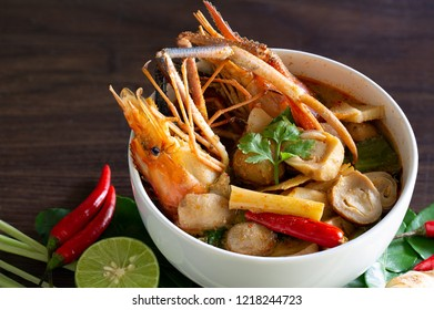 River prawn spicy soup (Tom yum koong) Thai food and ingredient vegetables / Select focus and space for texts