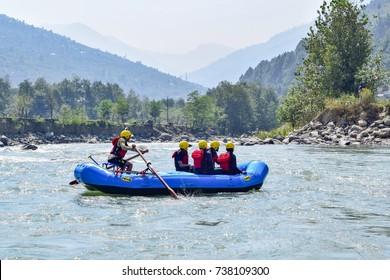 River rafting in Beas river at Kullu, Himachal Pradesh, India.