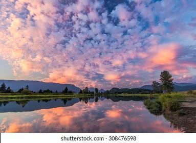 River reflection of pink clouds
