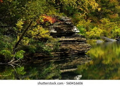 River Reflection with Rocks