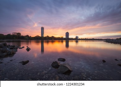 The River Rhine and the the city of Bonn, Germany, at sunset.