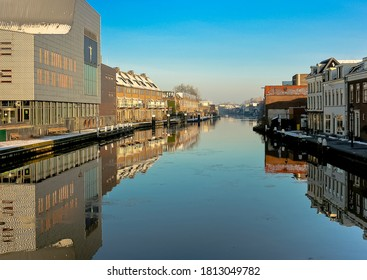 The river Rhine is flowing through the town Alphen aan den Rijn. In this photo the reflection is visible. The town is in the province Zuid-Holland.