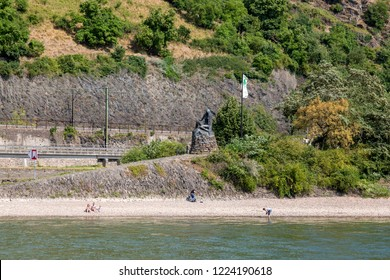 River Rhine, Germany - July 07, 2018: Bronze sculpture of a mermaid at the foot of the Loreley rock on the banks of the Rhine in Germany