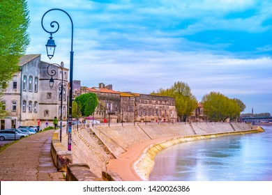 The river Rhone at Arles overlooking the old town. Buches du Rhone, Provence, France. Beautiful photo of travel destination in France.