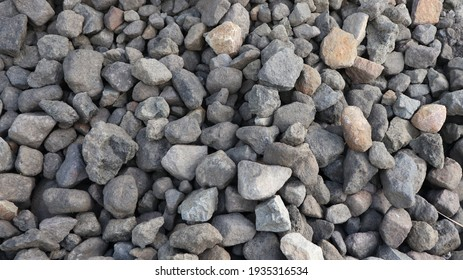 River Rock Stone Abstract Textured Background Pattern. Black Rock Stone. Grey Rock Stone.