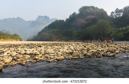 River rocks and  bamboo rafts in the Wuyi Mountains park in China