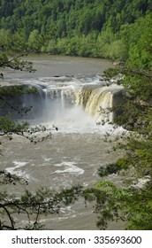 As the river rounds a bend, a wide rock outcropping creates a cascading waterfall as the river drops into the churning pool below.