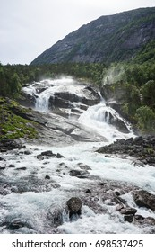 A river running through trees and rocks in Norway - V