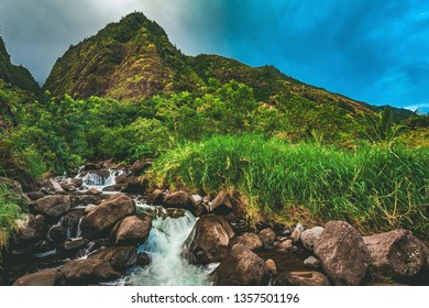 A river runs through the rainforest of Iao Valley State Park, located outside of Kahului and Wailuku in the West Maui Forest Reserve  on the island of Maui, Hawaii, United States.