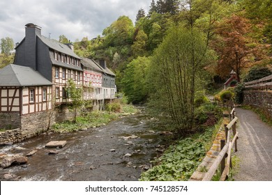River Rur in Monschau in the Eifel mountains, Germany, with historic houses and a hiking trail