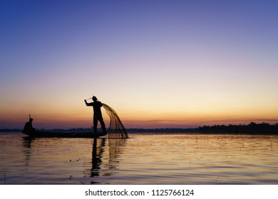 THE RIVER AT SAKONNAKHON PROVINCE IN THAILAND, CIRCA FEBRUARY 2017, an unidentified man Silhouette of traditional fishermen throwing net fishing at sunrise time, livelihoods of fishermen.