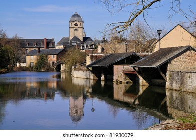 The river Sarthe with the basilica Notre Dame and two wash houses at Alençon of the Lower Normandy region in France