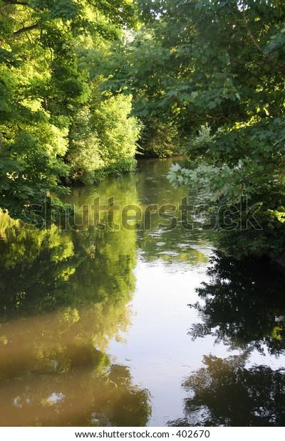 River scene in evening light (slight motion blur on near foliage