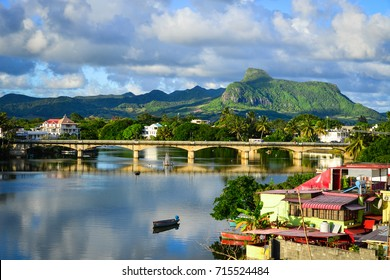 River scene with mountains in Mahebourg, Mauritius. Mauritius, an Indian Ocean island nation, is known for its beaches, lagoons and reefs.