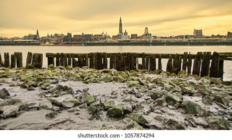 The river Scheldt has reached it's lowest point. The wooden structure comes above water forming a nice foreground for the city of Antwerp. The Belgian city also know as the city of diamond.