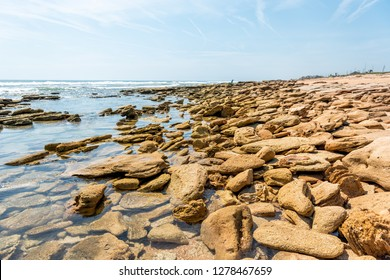 River to Sea Preserve, Marineland, rock formations and horizon in northern Florida beach by St Augustine with nobody on sunny day