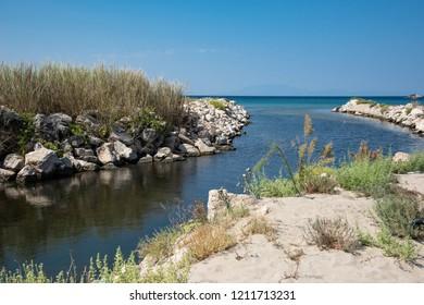 River and sea waters meet  near Kalagoria Beach, Greece