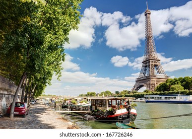 The River Seine with the Eiffel tower, Paris, France. Beautiful scenic vew of Paris in summer. Panorama of Paris in the sunlight. Cityscape of Paris on a sunny day.