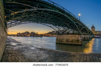 River Seine with Pont des Arts and Institut de France at sunrise in Paris, France