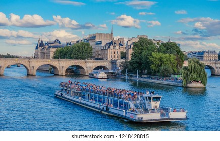 River Sena, Paris, France - July 30, 2018: River Sena in Paris, with boats and bridges in the front