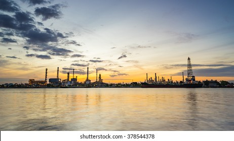 river side oil refinery industry plant along twilight morning
