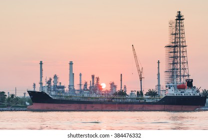 river side oil refinery industry plant along sunrise